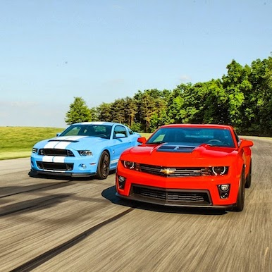 (left)2013 Shelby GT 500 and (right) the 2012 Chevrolet Camaro ZL1